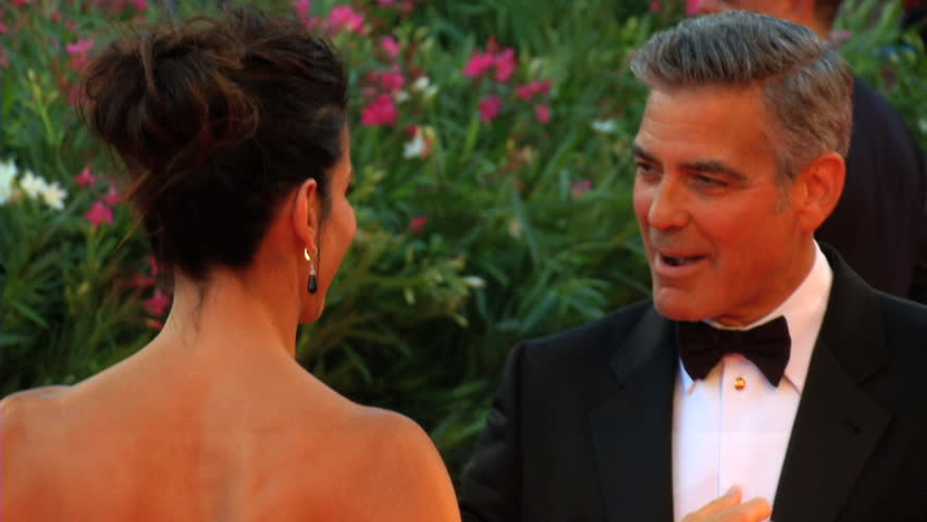 """VENICE - AUGUST 28: Sandra Bullock and George Clooney on the red carpet for the movie """"Gravity"""" during the 70th International Venice Film Festival on August 28, 2013 in Venice."""