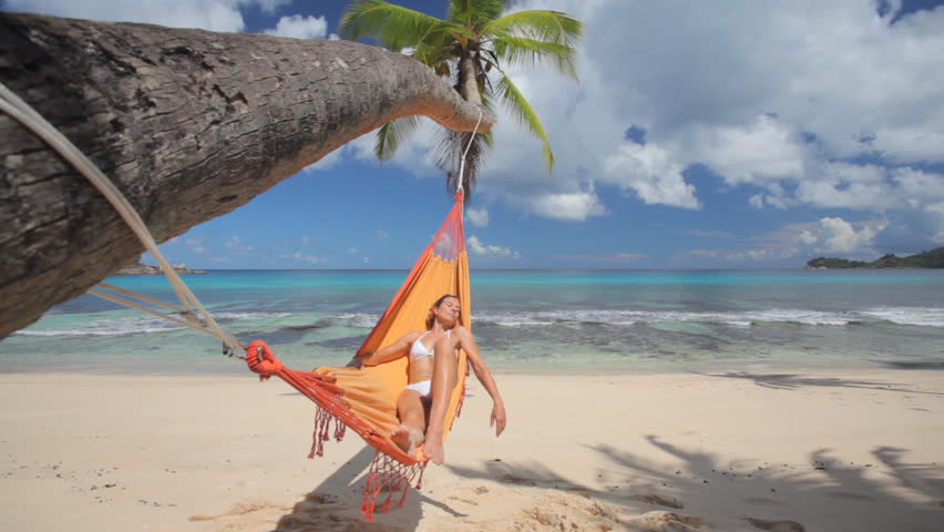 woman in hammock on palmtree