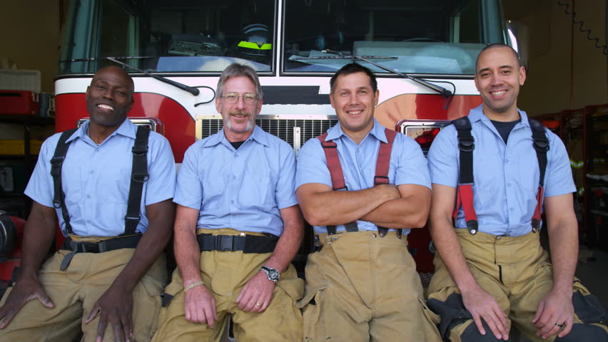 Portrait of firefighter group at station