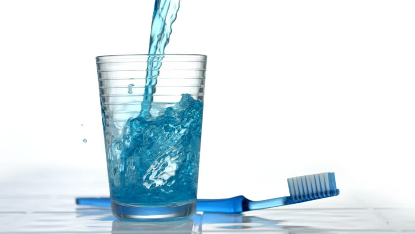 Mouthwash pouring into glass, slow motion - HD stock footage clip
