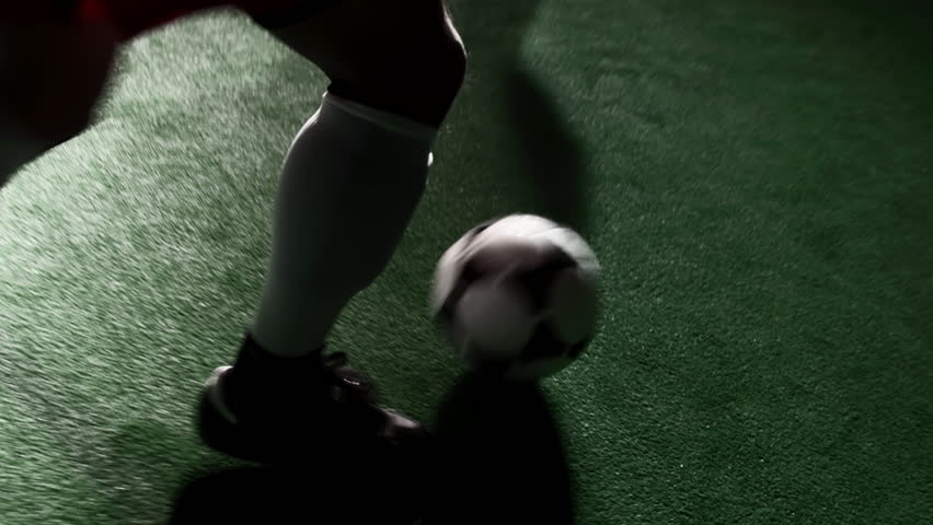 Soccer player dribbles the ball and fakes out defenders. Close up shot - HD stock footage clip