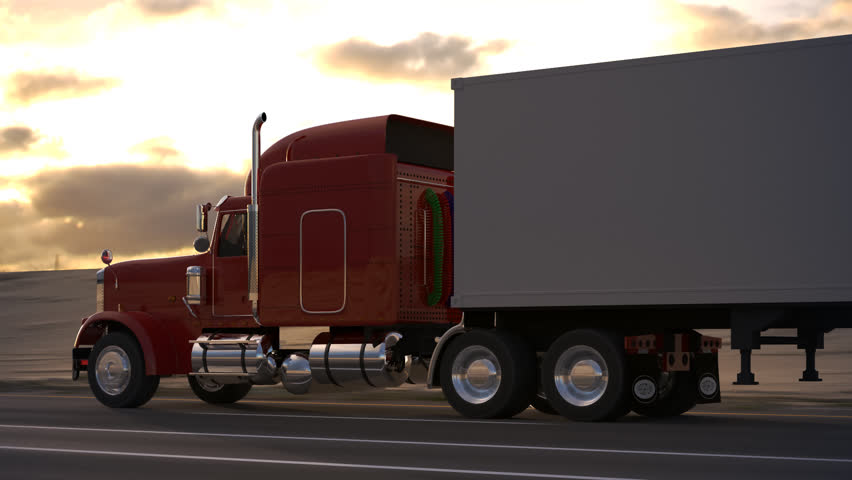 18 Wheel Truck on the road with sunset in the background ...