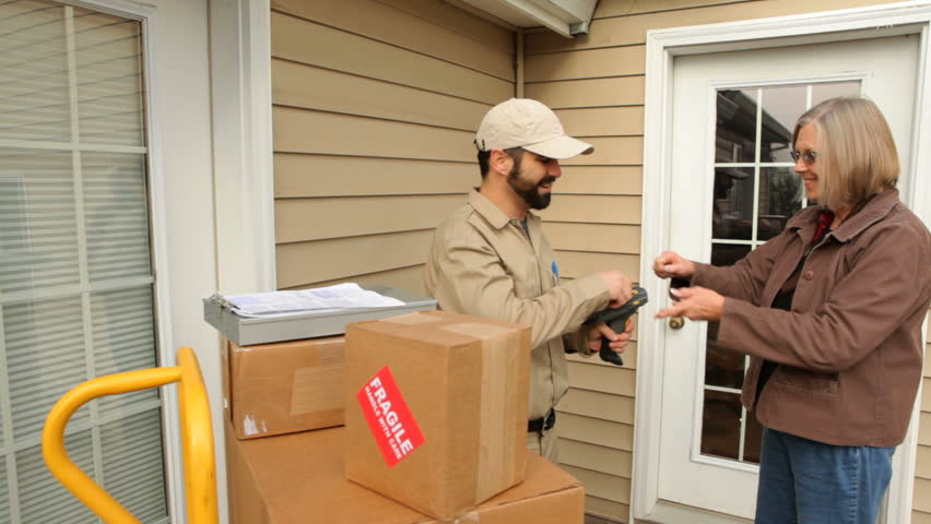 Man delivers packages to woman at home
