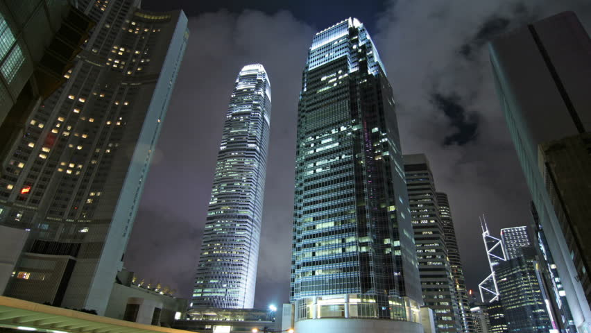 Timelapse shot. Contemporary commercial building in Hong Kong at night. - HD stock footage clip