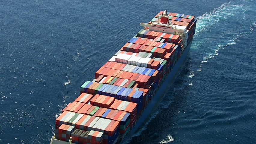 Aerial shot of container ship in ocean - HD stock footage clip