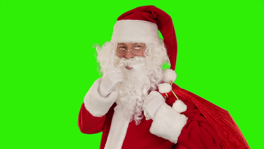 Santa Claus carrying his bag, looks at the camera sends a kiss and wave, Green Screen - HD stock video clip