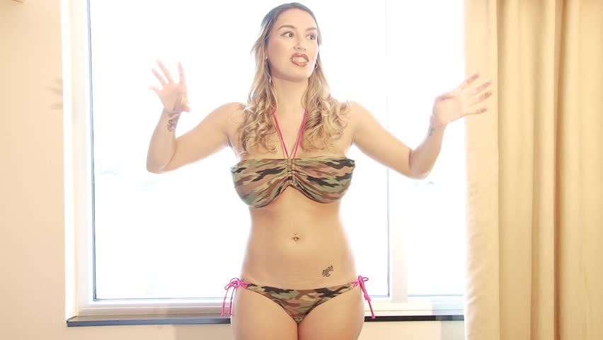 Sexy latina dancing in bikini