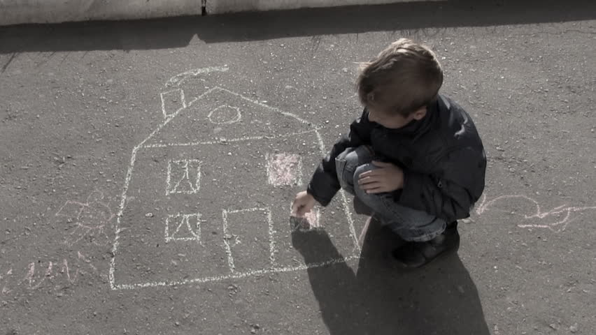 sad lonely child draws a house