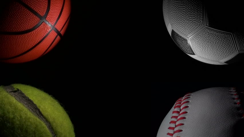 Sports balls against black loop - HD stock footage clip