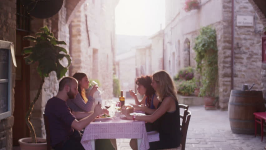 Four friends eating gourmet dishes in a elegant restaurant - HD stock footage clip