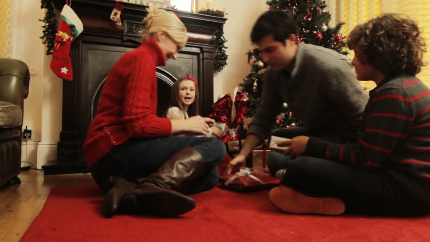 DOLLY: Christmas Gifts - A family hands out Christmas presents to each other