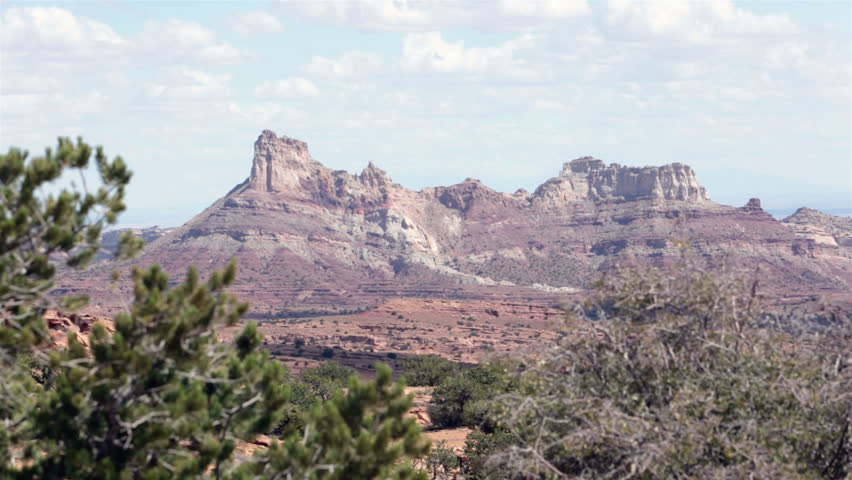 Sandstone butte mountain San Rafael Swell southern Utah desert. Temple Mountain. Spectacular sandstone monument. Rich mining history and interesting geological features. Once an active uranium mine.