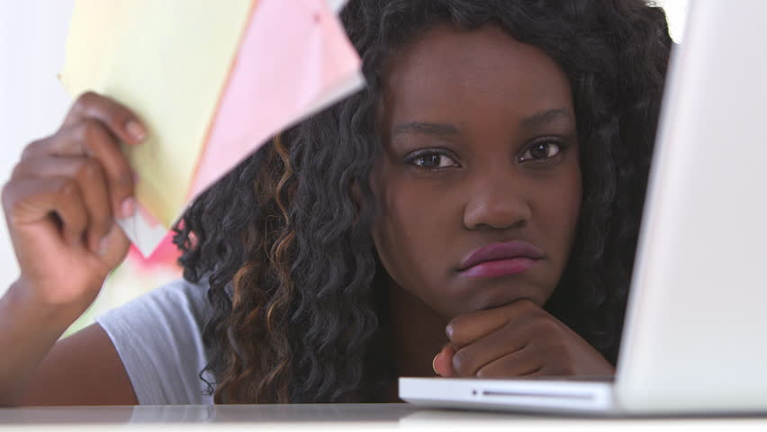 Unhappy black woman with bills - HD stock footage clip