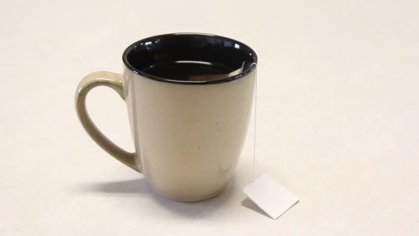 Dip Teabag In Take-away Cup Full Of Hot Water. Stock ...