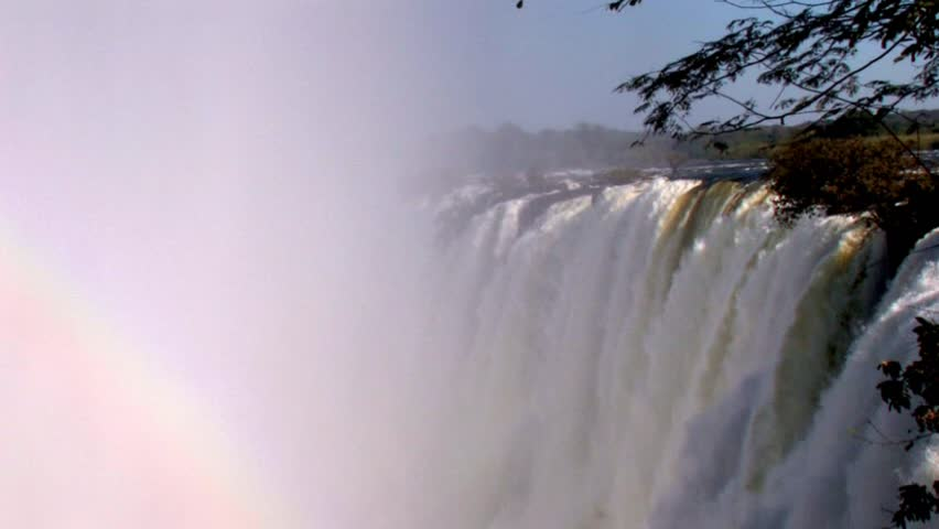 Stunning view of Victoria Falls during rainy season with double rainbow - HD stock footage clip