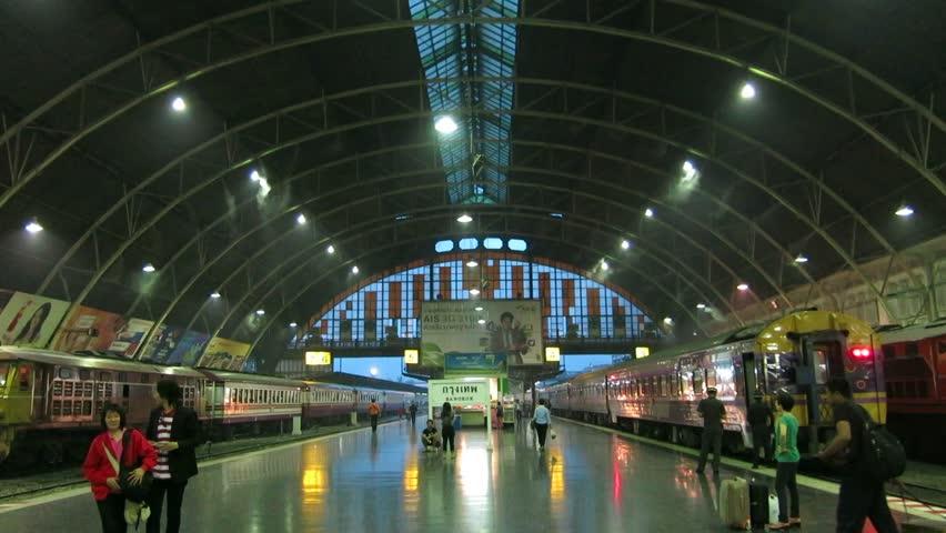Bangkok, Thailand – October 17, 2013: Embarking and disembarking rail passengers walk through the platforms at Hua Lamphong Railway Station (Bangkok Railway Station).