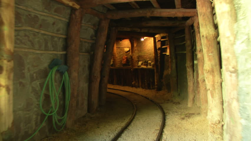 Mine tunnel with rails and light - HD stock video clip