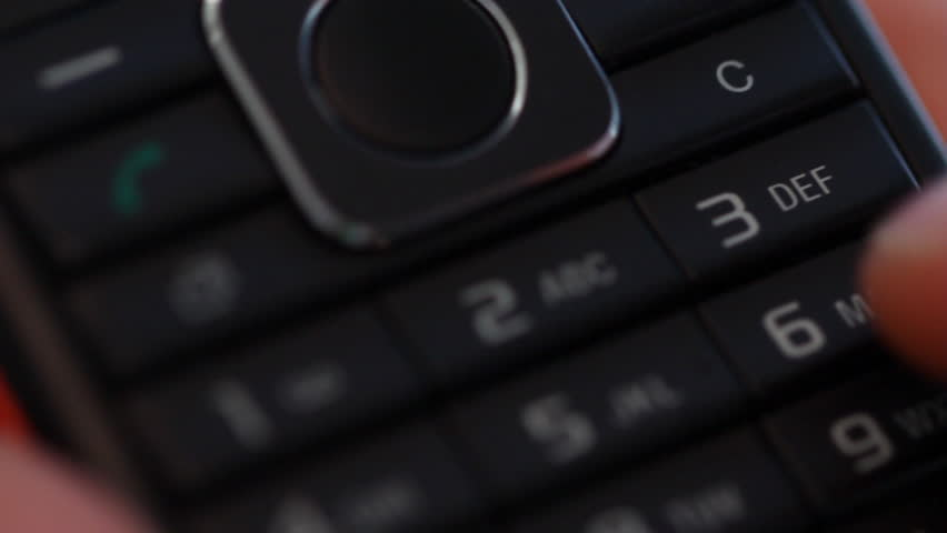 Someone holds mobile phone and typing 911 number - HD stock footage clip