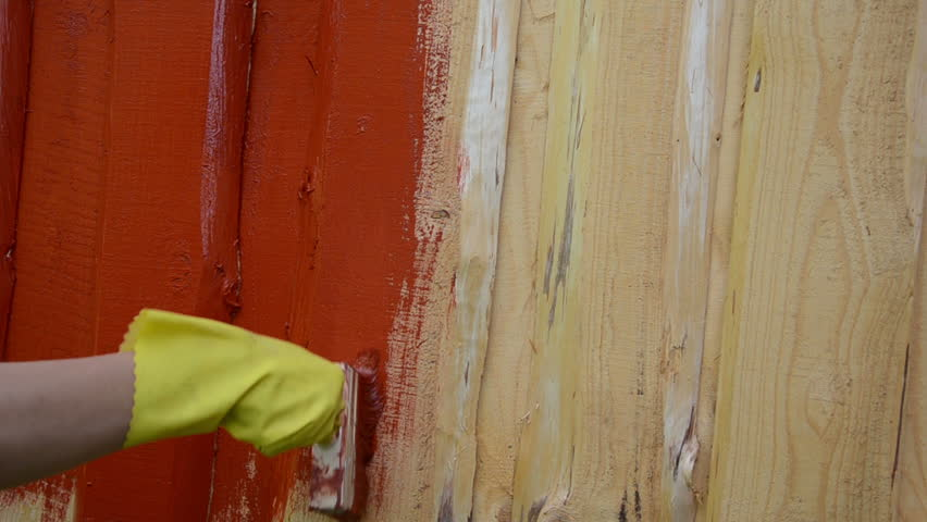 Mans Hand With White Glove Paint Wooden Boards With Bright