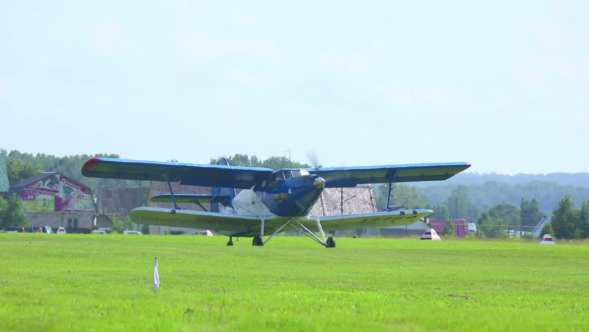 NOVOSIBIRSK, RUSSIA - JULY 28, 2013: An-2 turboprop biplane taxiing on the airfield before taking off, celebration of Aviator's day airshow on July 28, 2013 in Mochishe airdrome, Novosibirsk, Russia.
