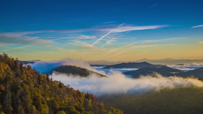 Autumn Sunrise over the Blue Ridge Mountains with Fast Moving Mist and Clouds seen from the Blue Ridge Parkway near Asheville in Western North Carolina.