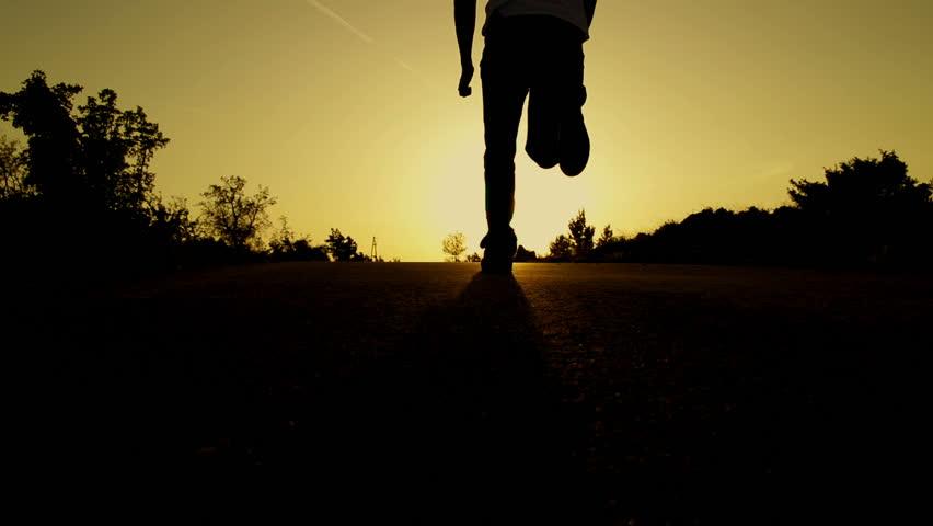 SLOW MOTION: man running at sunset