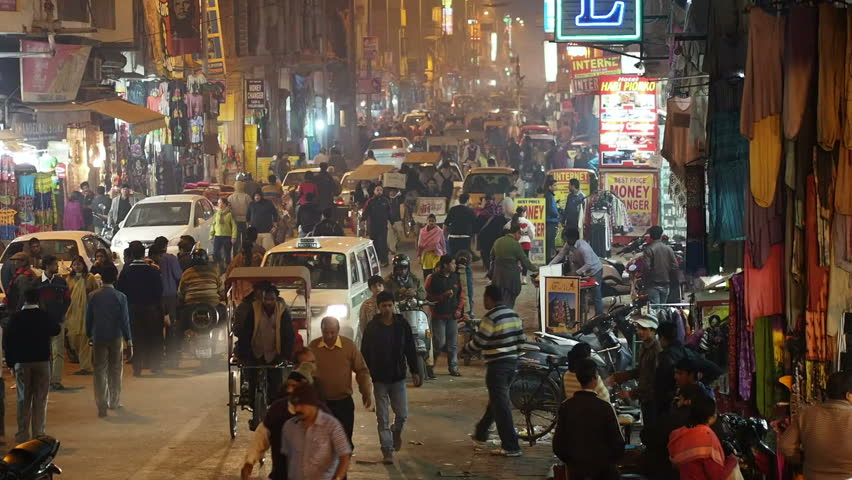 New Delhi, India - January 16, 2013: People and traffic at night on a busy street in the neighborhood of Paharganj, New Delhi, India.