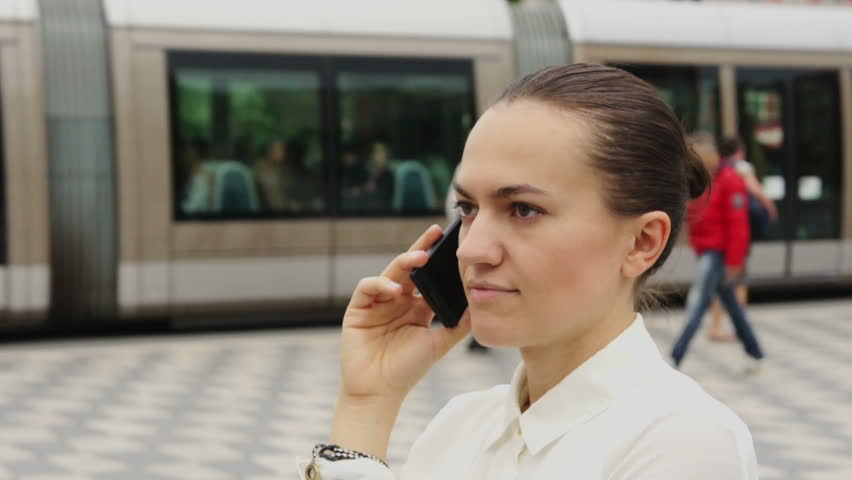 Young businesswoman at phone in an urban setting