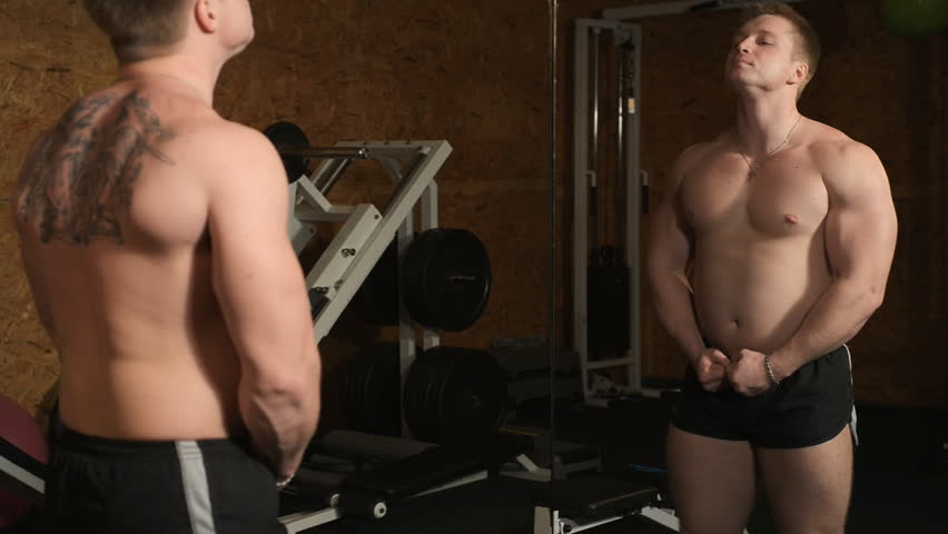 Healthy muscular young man engaged in bodybuilding  - HD stock footage clip