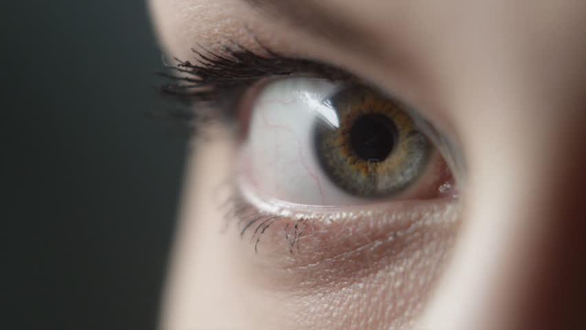 Girl doing eye makeup close up