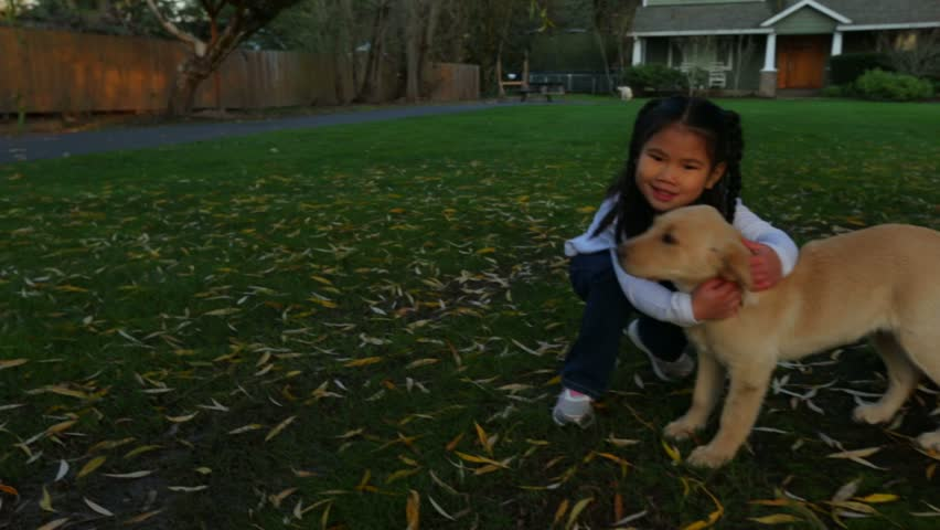 Young girl gives her puppy a hug - HD stock video clip