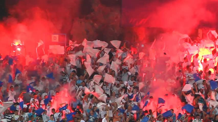 RIJEKA, CROATIA - AUGUST 22: UEFA Europa League play off match HNK Rijeka vs. VfB Stuttgart. Soccer fans celebrate at the stadium on August 22, 2013 in Rijeka
