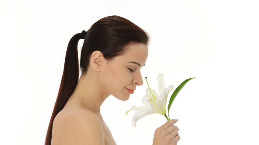 Portrait of beautiful young woman with health skin and with lily flower  - HD stock footage clip