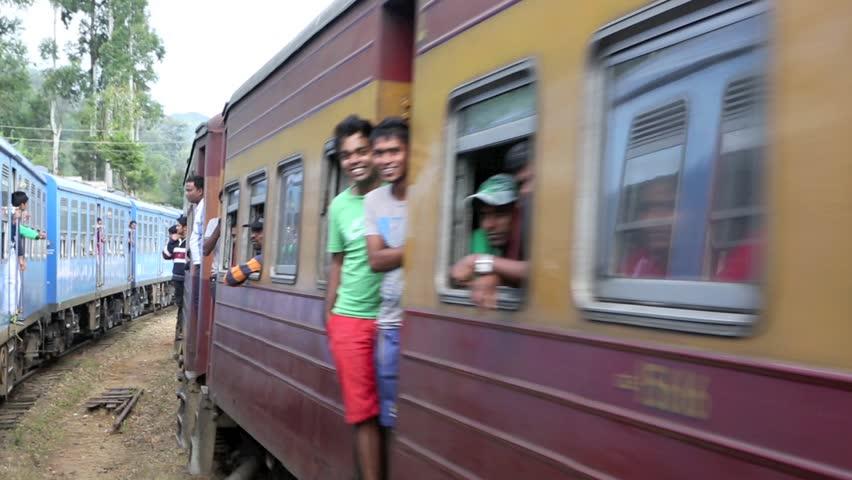BANDARAWELA, SRI LANKA - OCTOBER 17: Passenger trains passing each other in opposite directions at train station on October 17, 2013 in Bandarawela, Sri Lanka