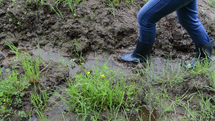 Woman legs with gumboots rubber boots walk on wet dirt for Soil 7t7 woman