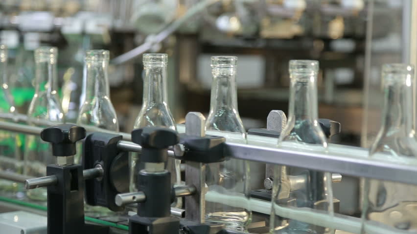empty transparent bottles for cognac - HD stock video clip