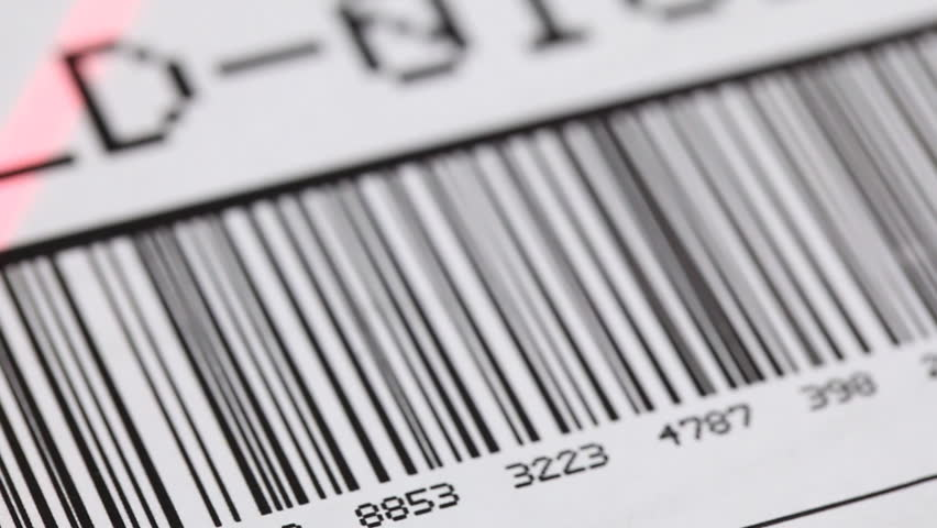 Barcode on shipping label on box scanned by automatic laser scanner