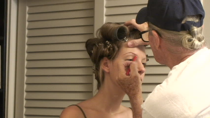 Makeup artist working on a beautiful models eyebrows - SD stock video clip