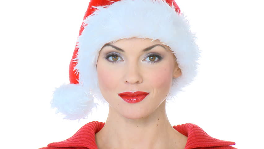 Beautiful sexy girl sending kiss, she is wearing santa claus hat