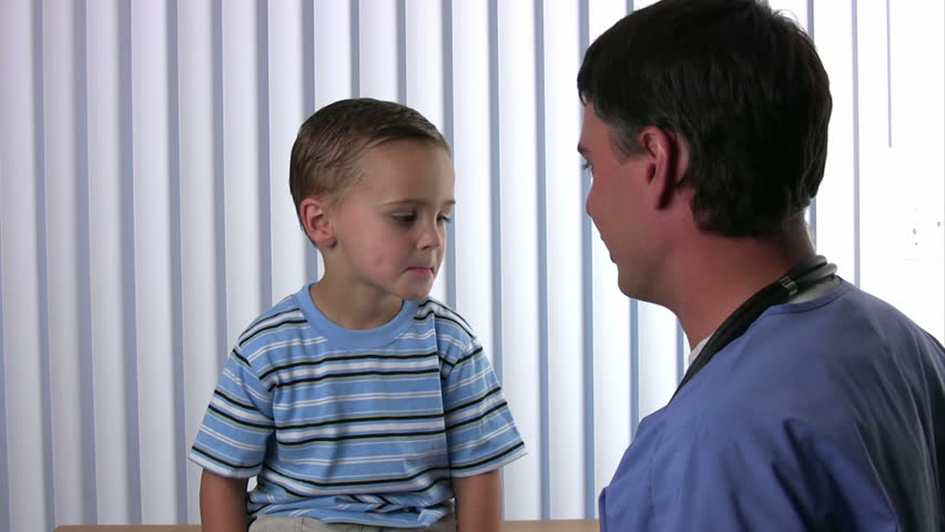 Doctor Pediatrician With A Stethophonendoscope Listens To