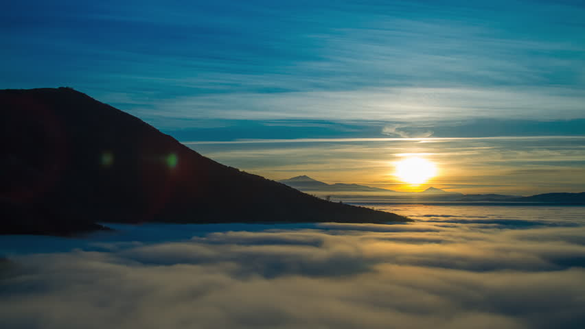 4K sunset timelapse of mountain heights with dense layer of fog