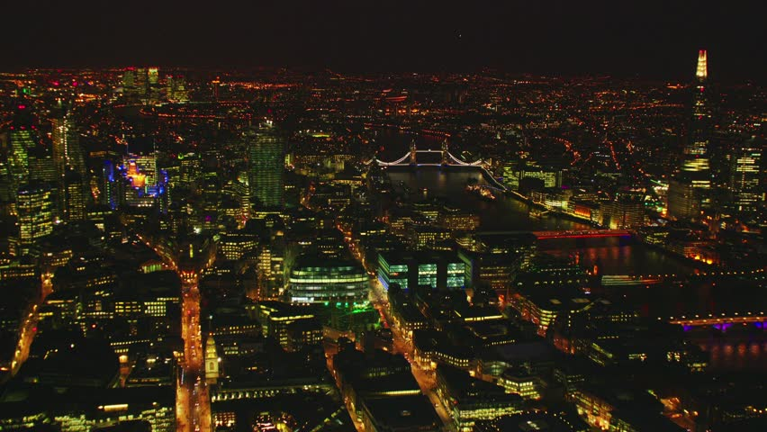 Aerial shot of Central London at night with view of the Shard, River Thames, Tower Bridge & London's Financial District