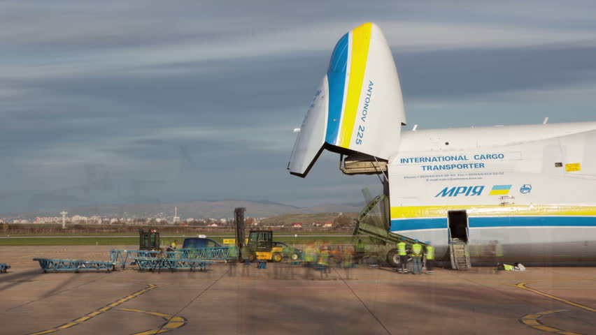 ZAGREB, CROATIA - NOVEMBER 10: Loading heavy weight cargo to the Antonov 225 Mriya airplane on November 10, 2013 Zagreb, Croatia. It is the biggest airplane in the world.