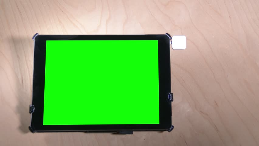 Swiping a fictional credit card on a green screen tablet PC. With optional luma matte.