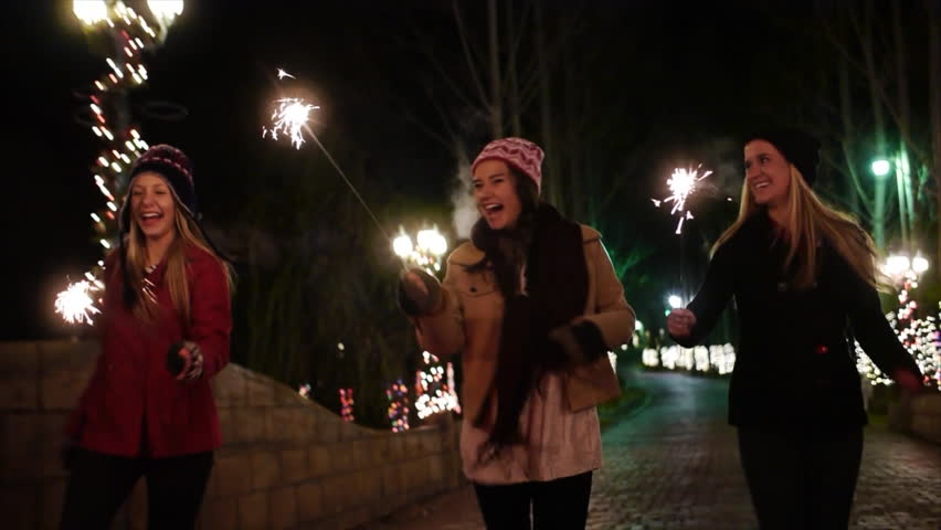 Teen Girls w/Sparklers Run Out The Gate Of A Winter Wonderland – Slow Motion