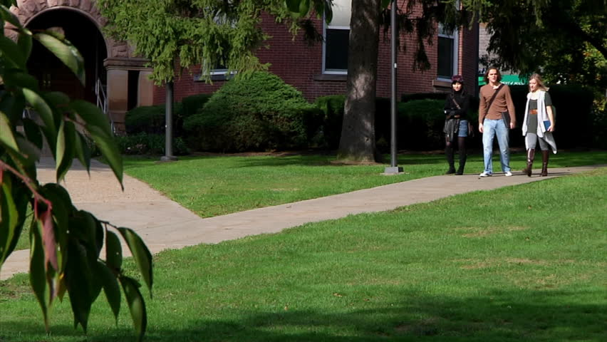 College students walk to class. - HD stock footage clip