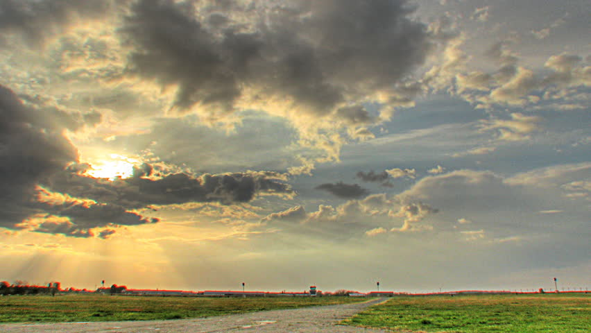 Time lapse of sunset over an airport, HDR imaging (high dynamic range) - HD stock video clip