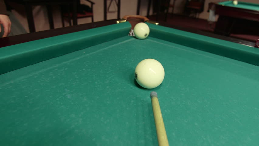 Game of billiards in pool room - shot in corner pocket POV - HD stock video clip