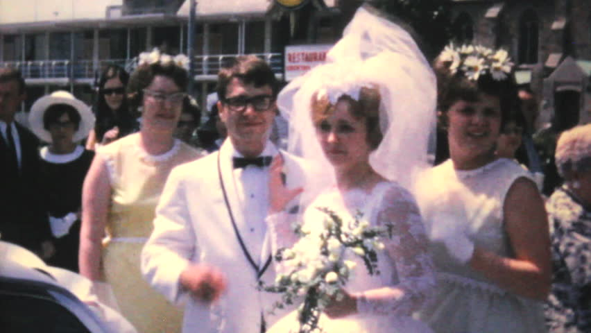 PITTSBURGH, PENNSYLVANIA, 1966: A newly married couple leaves the church and gets into their getaway car during their wedding of 1966.