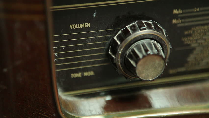 Very old Retro Radio, Hand Raising volume, Close Up, Using shallow depth of Field  - Full HD 1920X1080